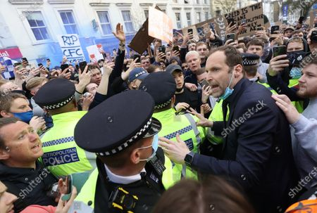 Petr Cech talks with fans as they protest against the proposed European Super League ahead of the match between Chelsea and Brighton at Stamford Bridge Stadium