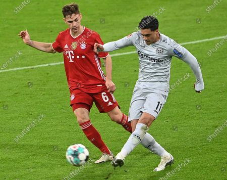 Bayern's Joshua Kimmich (L) in action against Leverkusen's Nadiem Amiri (R) during  the German Bundesliga soccer match between FC Bayern Munich and Bayer 04 Leverkusen in Munich, Germany, 20 April 2021.