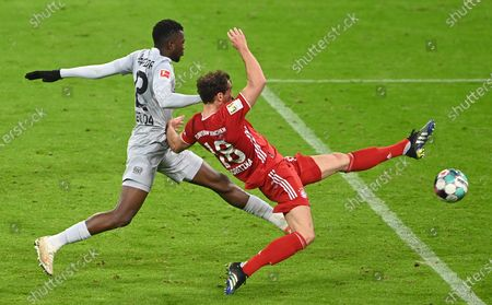 Leverkusen's Santiago Arias (L) in action against Bayern's Leon Goretzka (R) during  the German Bundesliga soccer match between FC Bayern Munich and Bayer 04 Leverkusen in Munich, Germany, 20 April 2021.