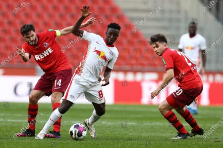 Cologne midfielder Jonas Hector, left, and Cologne's Elvis Rexhbeçaj in action, with Leipzig's Amadou Haidara, right, during their German Bundesliga Soccer match in Cologne, Germany