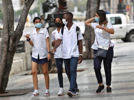 Medicine students walk in Havana, Cuba, 20 April 2021. Cuban President Miguel Diaz-Canel Bermudez was elected First Secretary at Cuba's communist party congress on 19 April 2021, succeeding Raul Castro who was stepping down as the leader of the party.