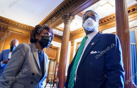 Stock Photo of Rep. Maxine Waters, D-Calif., left, and Rep. Emanuel Cleaver, D-Mo., join other members of the Congressional Black Caucus to await the verdict in the murder trial of former Minneapolis police Officer Derek Chauvin in the death of George Floyd, on Capitol Hill in Washington