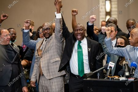 Marc Morial, from left, Philonise Floyd,  Attorney Ben Crump and Rev. Al Sharpton walk with their hands in the air during a news conference after the verdict was read in the trial of former Minneapolis police officer Derek Chauvin in the death of George Floyd on April 20, 2021 in Minneapolis, MN.
