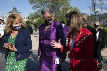 House Speaker Nancy Pelosi of Calif., right, speaks with Rep. Lucy McBath D-Ga., left, and Rep. Joyce Beatty, D-Ohio, Chairwoman of the Congressional Black Caucus, on Capitol Hill in Washington, after the jury convicted former Minneapolis police officer Derek Chauvin of murder and manslaughter in the death of George Floyd