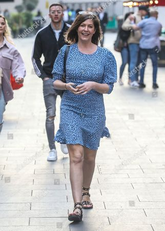 Stock Photo of Lucy Horobin seen departing from her Heart Dance show the Global Radio Studios in London.