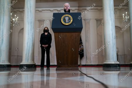 US President Joe Biden (C) delivers remarks as US Vice President Kamala Harris (L) looks on, after former Minneapolis Police Department Police Officer Derek Chauvin was found guilty on all counts in the death of George Floyd, at the White House in Washington, DC, USA, 20 April 2021.