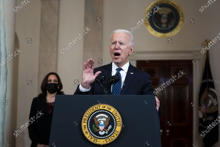 Stock Picture of US President Joe Biden (R) delivers remarks as US Vice President Kamala Harris (L) looks on, after former Minneapolis Police Department Police Officer Derek Chauvin was found guilty on all counts in the death of George Floyd, at the White House in Washington, DC, USA, 20 April 2021.