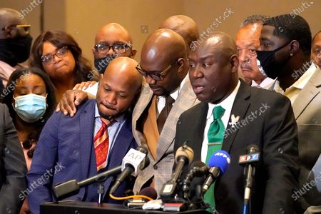 Stock Picture of Philonise Floyd, center, brother of George Floyd, shares a hug with attorney Chris Stewart, left, as attorney Ben Crump speaks during a news conference after the verdict was read in the trial of former Minneapolis Police officer Derek Chauvin, in Minneapolis