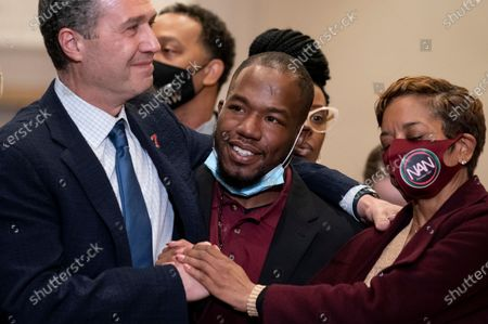 Donald Williams, a witness in the murder trial against former Minneapolis police Officer Derek Chauvin in the killing of George Floyd, smiles during a news conference after Chauvin's conviction, in Minneapolis