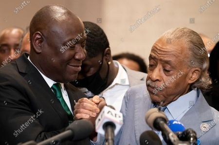 Attorney Ben Crump, left, and Rev. Al Sharpton shake hands during a news conference after former Minneapolis police Officer Derek Chauvin is convicted in the killing of George Floyd, in Minneapolis