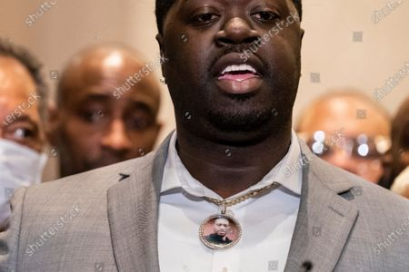 Brandon Williams, nephew of George Floyd, wears a pendant bearing the likeness of his uncle during a news conference after former Minneapolis police Officer Derek Chauvin is convicted in the killing of George Floyd, in Minneapolis