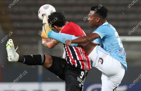 Stock Picture of Nilson Loyola of Peru's Sporting Cristal, right, and Pablo of Brazil's Sao Paulo battle for the ball during a Copa Libertadores soccer match at the National Stadium in Lima, Peru