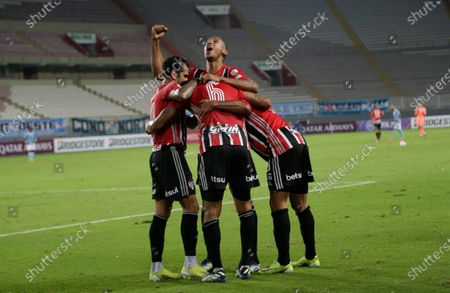 Stock Photo of Players of Brazil's Sao Paulo celebrate their side's 3rd goal scored by teammate Eder Citadin during a Copa Libertadores soccer match against Peru's Sporting Cristal at the National Stadium in Lima, Peru