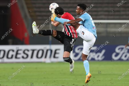 Nilson Loyola (R) of Sporting Cristal vies for the ball with Pablo Teixeira of Sao Paulo during the Copa Libertadores soccer match between Sporting Cristal and Sao Paulo at Nacional stadium in Lima, Peru, 20 April 2021.