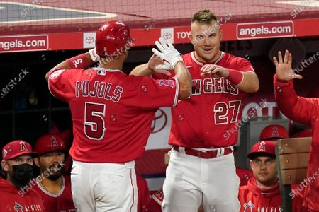 Stock Picture of Los Angeles Angels' Albert Pujols, left, is congratulate by Mike Trout after hitting a solo home run during the seventh inning of a baseball game against the Texas Rangers, in Anaheim, Calif