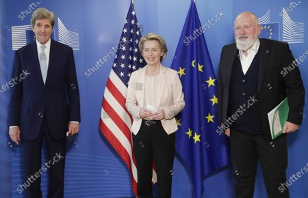 United States Special Presidential Envoy for Climate John Kerry, left, European Commission President Ursula von der Leyen, center, and European Commissioner for European Green Deal Frans Timmermans pose for photographers prior to a meeting at EU headquarters in Brussels. The European Union reached a tentative climate deal on that should make the 27-nation bloc climate-neutral by 2050, with member states and parliament agreeing on the targets on the eve of a virtual summit that U.S. President Biden will host