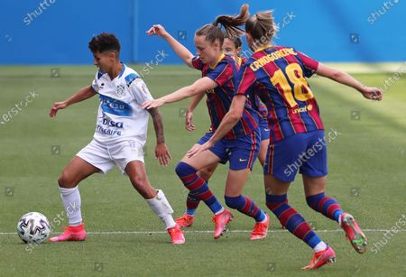 Stock Image of Maria Jose Perez and Caroline Graham Hansen during the match between FC Barcelona and UD Granadilla Tenerife, corresponding to the week 16 of the spanish women's league Primera Iberdrola, played at the Johan Cruyff Stadium, on 20th April 2021, in Barcelona, Spain.  --