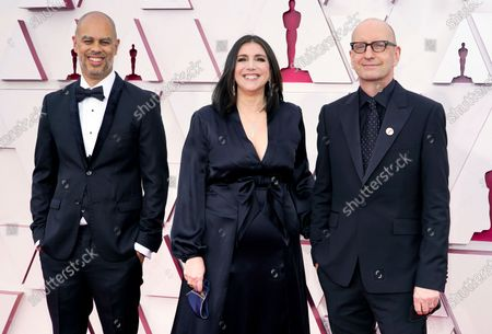 Jesse Collins, from left, Stacey Sher, and Steven Soderbergh arrive at the Oscars