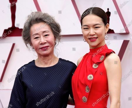 Youn Yuh-jung, left, and Han Ye-ri arrive at the Oscars