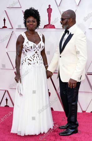 Viola Davis, left, and Julius Tennon arrive at the Oscars