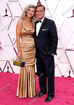Paulina Porizkova, left, and Aaron Sorkin arrive at the Oscars