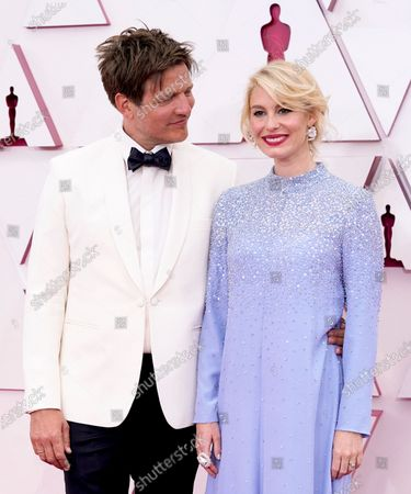 Thomas Vinterberg, left, and Helene Reingaard Neumann arrive at the Oscars