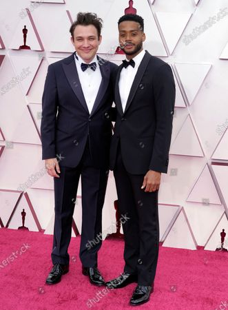 Ben Proudfoot, left, and Kris Bowers arrive at the Oscars