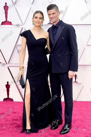 Emily Arlook, left, and Will McCormack arrive at the Oscars