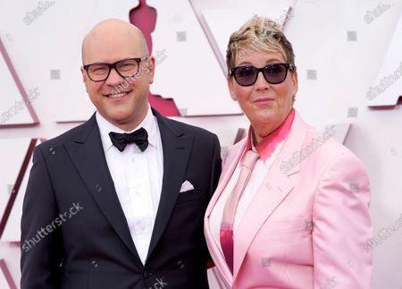Dan Scanlon, left, and Kori Rae arrive at the Oscars
