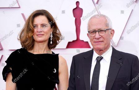 Stock Image of Sophie Newton, left, and James Newton Howard arrive at the Oscars