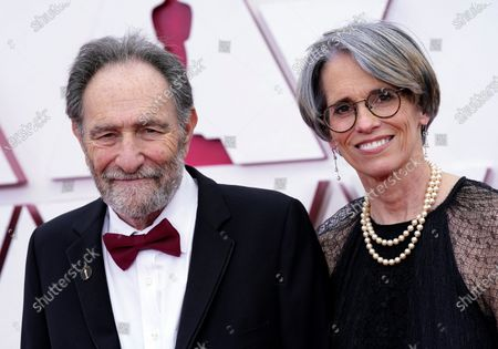 Eric Roth, left, and Debra Greenfield arrive at the Oscars