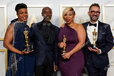 "Don Cheadle, second left, poses with the winners of the award for best makeup and hairstyling for ""Ma Rainey's Black Bottom,"" Mia Neal, from left, Jamika Wilson and Sergio Lopez-Rivera in the press room at the Oscars"