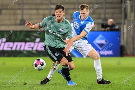 (210421) - BIELEFELD, April 21, 2021 (Xinhua) - Klaas-Jan Huntelaar (L) of Schalke 04 controls the ball under the defense from Joakim Nilsson of Bielefeld during a German Bundesliga match between Arminia Bielefeld and FC Schalke 04 in Bielefeld, Germany, April 20, 2021. (Photo by Ulrich Hufnagel/Xinhua) GERMANY OUT. FOR EDITORIAL USE ONLY. - Ulrich Hufnagel -