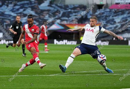 Toby Alderweireld (R) of Tottenham tries to block Theo Walcott (L) of Southampton shot at goal.