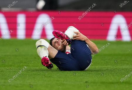 Giovani Lo Celso of Tottenham goes down holding his left ankle.