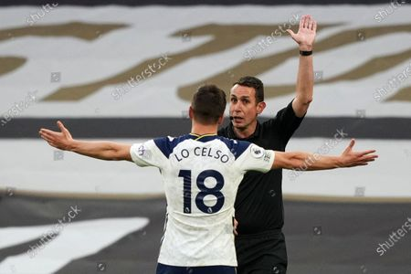 Giovani Lo Celso of Tottenham objects as Referee David Coote disallows Tottenham's second goal after VAR.