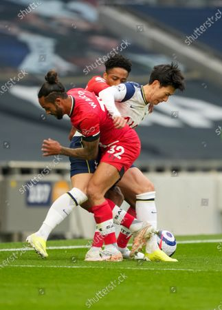 Son Heung-Min of Tottenham is double teamed by Theo Walcott and Kyle Walker-Peters of Southampton