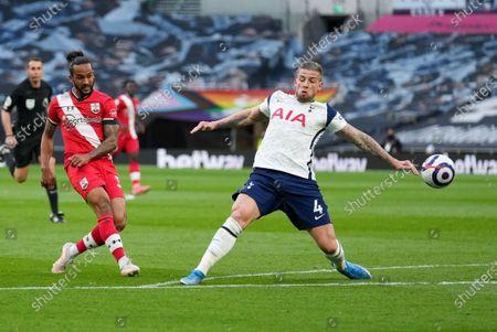 Theo Walcott of Southampton and Toby Alderweireld of Tottenham