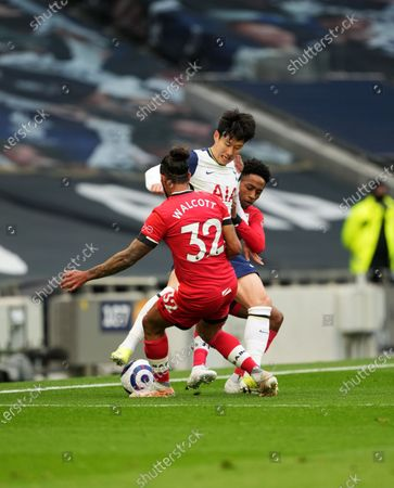Son Heung-Min of Tottenham gets double teamed by Theo Walcott of Southampton and Kyle Walker-Peters of Southampton.