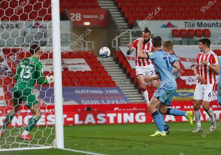 Stoke City's Stephen Fletcher heads at goal