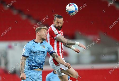 Stock Image of Stoke City's Stephen Fletcher battles with Kyle McFadzean of Coventry City