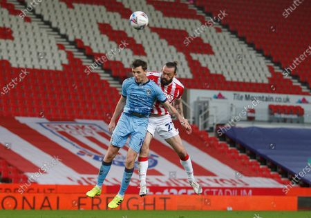 Stoke City's Stephen Fletcher hits the bar with this header