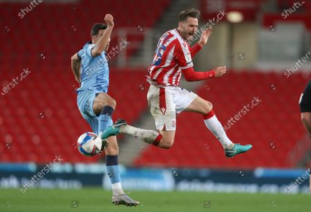 Stoke City's Nick Powell is fouled by Matty James of Coventry City