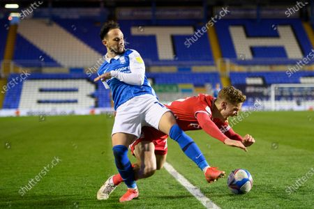 Ivan Sanchez of Birmingham City is challenged by Ryan Yates of Nottingham Forrest.