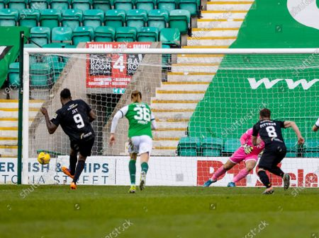 Jay Emmanuel-Thomas of Livingston pulls one back for Livingston from the penalty spot to make it 2-1 in minute 85; Easter Road, Edinburgh, Scotland; Scottish Premiership Football, Hibernian versus Livingston.