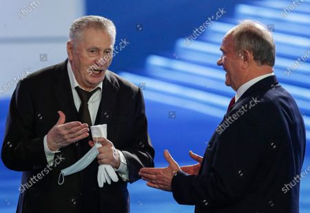 Stock Picture of Russian Liberal Democratic Party (LDPR) leader Vladimir Zhirinovsky (L) speaks with Russian Communist Party (KPRF) leader Gennady Zyuganov (R), during Russian President Vladimir Putin annual address to the Federal Assembly at the Manezh Central Exhibition Hall in Moscow, Russia, 21 April 2021. About 1,100 people including lawmakers of Russian two-chamber parliament, Government members, heads of the Constitutional and Supreme courts, and regional governors, were invited to attend the event. About 435 Russian and foreign journalists were accredited to cover the event.