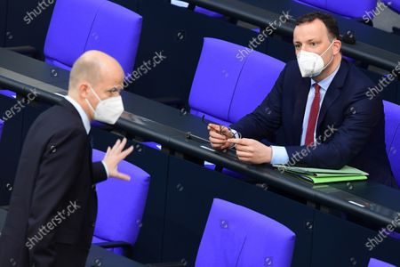 German Health Minister Jens Spahn (R) and Christian Democratic Union (CDU) and Christian Social Union (CSU) faction chairman in the German parliament Bundestag Ralph Brinkhaus talk during a session of the German parliament Bundestag in Berlin, Germany, 21 April 2021. The German parliament consults about a change of the Protection against Infection Act (Infektionsschutzgesetz). With the changes discussed, the federal government shall be granted with more power regarding the enforcement of Coronavirus measures in the federal states.