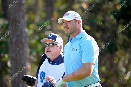 Brian Urlacher, right, watches his tee shot on the second hole during the final round of the Tournament of Champions LPGA golf tournament, in Lake Buena Vista, Fla