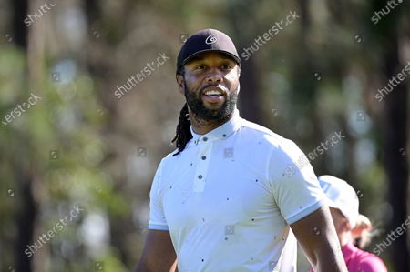 Larry Fitzgerald walks on the second hole after hitting his tee shot during the final round of the Tournament of Champions LPGA golf tournament, in Lake Buena Vista, Fla