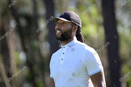 Stock Photo of Larry Fitzgerald watches his tee shot on the second hole during the final round of the Tournament of Champions LPGA golf tournament, in Lake Buena Vista, Fla